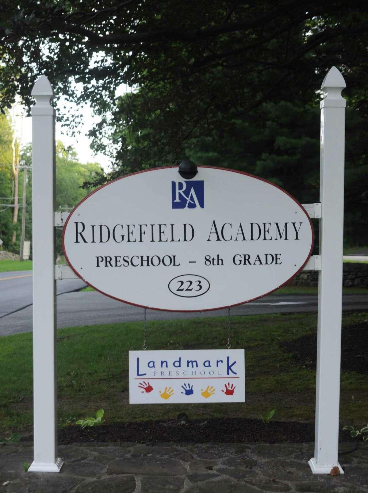 "The ""Landmark Preschool"" sign hangs underneath the Ridgefield Academy marker at the shared campus off West Mountain Road. Landmark also has preschools in Westport and Bedford, N.Y."