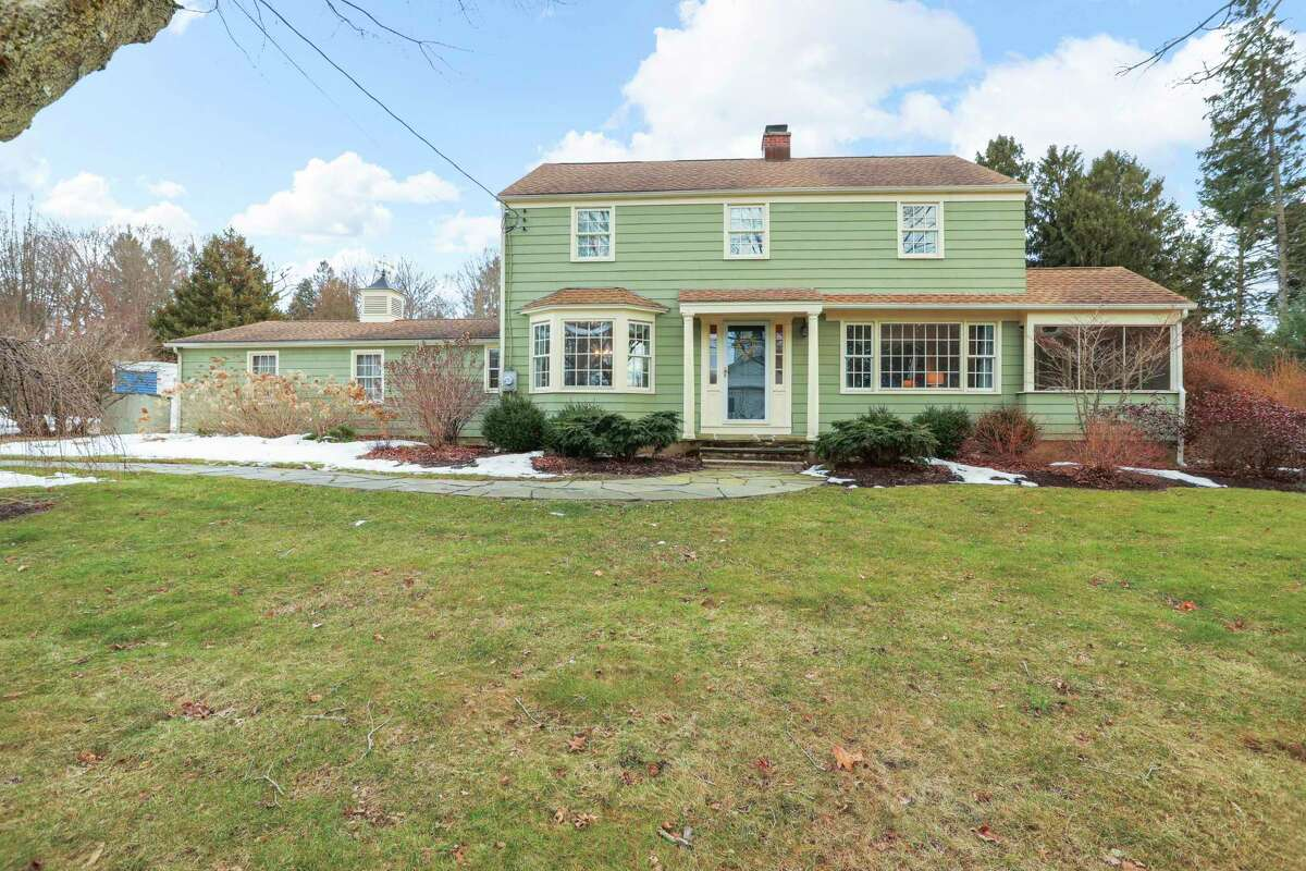 Sage green-colored colonial house with ivory trim at 26 Flat Rock Road, Easton.