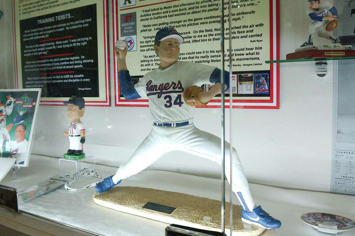 Cases filled with Nolan Ryan memorabilia are part of a new permanent exhibit at the Alvin Historical Museum.