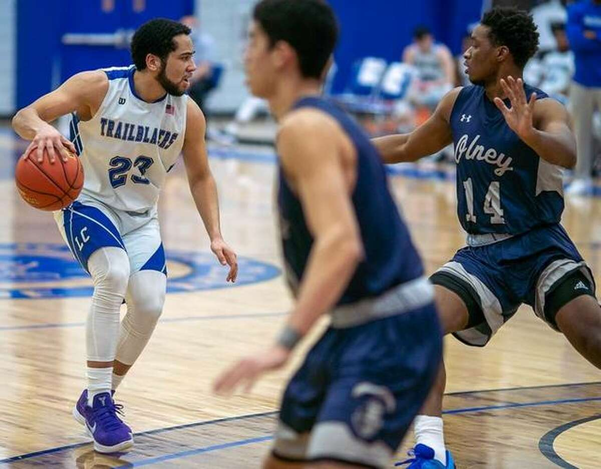 Lewis and Clark's Zidane Moore (23) dribbles the ball against Olney Central College earlier this season. Defending for OCC is Jordan Graham (14). Olney is the No. 3 seed in the upcoming Region 24 District 16 Tournament. John A. Logan College is No. 1 and Vincennes University is No. 2. LCCC's season ended last week with a positive COVID test and ensuing two-week quarantine.