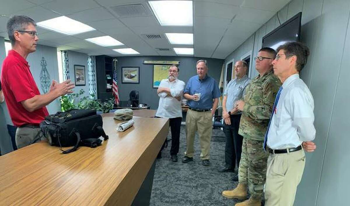 In this August 2019 file photo, Hal Graef, project manager with the U.S. Army Corps of Engineers St. Louis District, presents information to Wood River Drainage and Levee District President Ron Carnell, Metro East Sanitary District Director Stephen Adler, Southwestern Illinois Flood Prevention District Chief supervisor Chuck Etwert, U.S. Army Col. Bryan K. Sizemore, commander of the St. Louis District and Madison County Board Chairman Kurt Prenzler on the new partnership agreement for the Wood River Levee System reconstruction project.