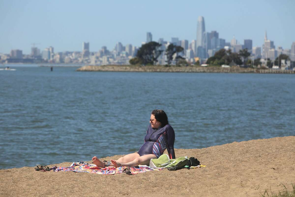 Stephanie Zinnie of Oakland takes in the sun at Robert W. Crown Memorial State Beach in Alameda on March 30, 2021.
