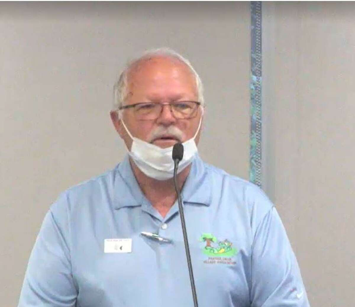 Everett Ison, president of the Panther Creek Village Association board, speaks on March 24 at the township Board of Directors meeting.