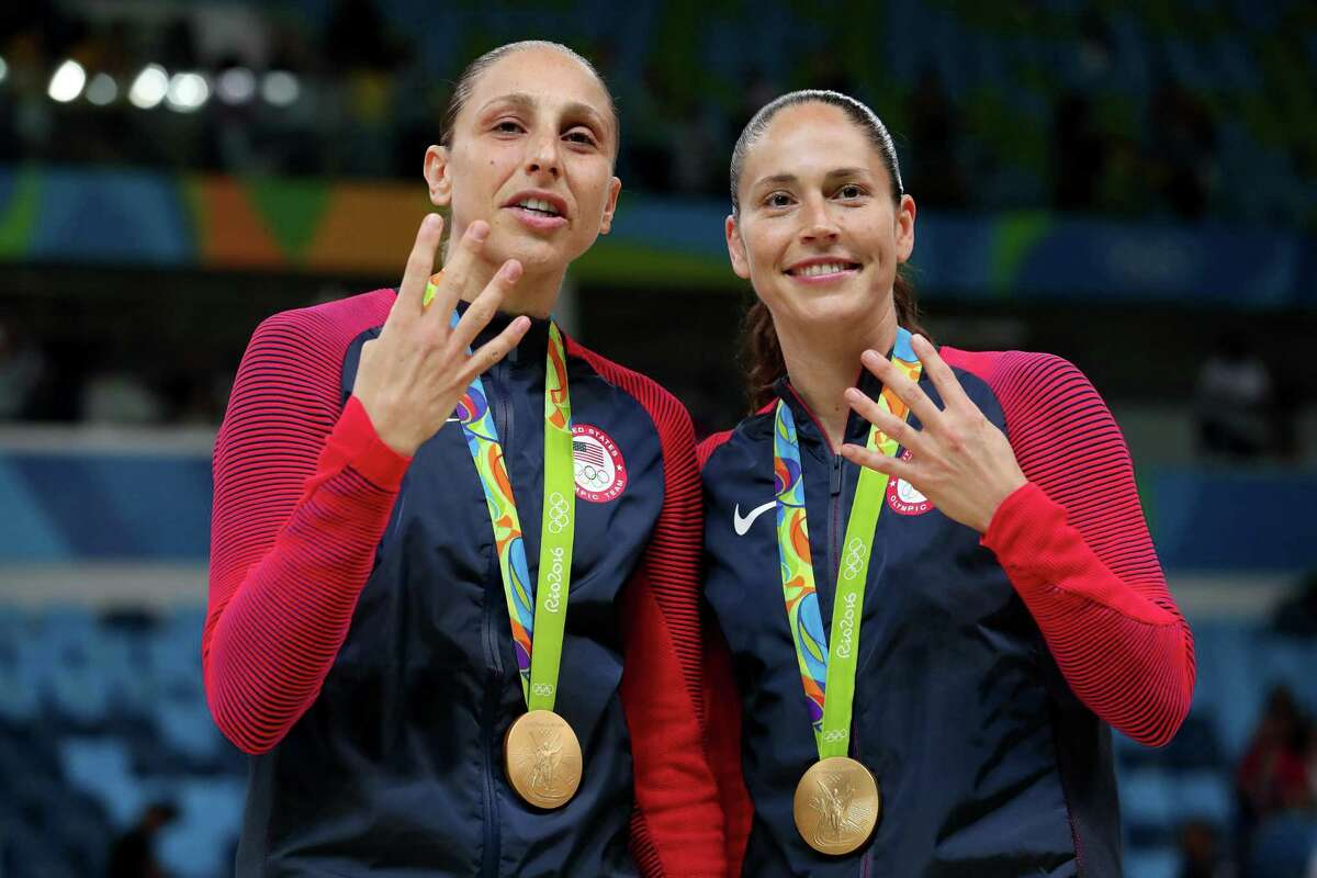 UConn alums Diana Taurasi and Sue Bird celebrate after winning their fourth career gold medal at the 2016 Olympics in Brazil.