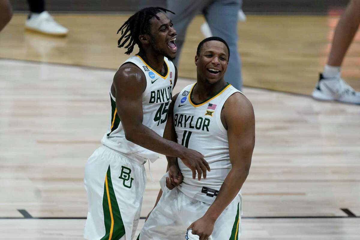 Baylor's Davion Mitchell (45) and Mark Vital celebrate Monday's 81-72 victory over Arkansas, which sent the Bears to their first Final Four in 71 years.