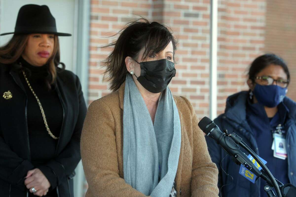 Tammy Papa, Director of Youth Services for the City of Bridgeport's Lighthouse Program, speaks at a news conference outside the Bridgeport Health Department's Communicable Disease Clinic in Bridgeport, Conn. Jan. 9, 2021.