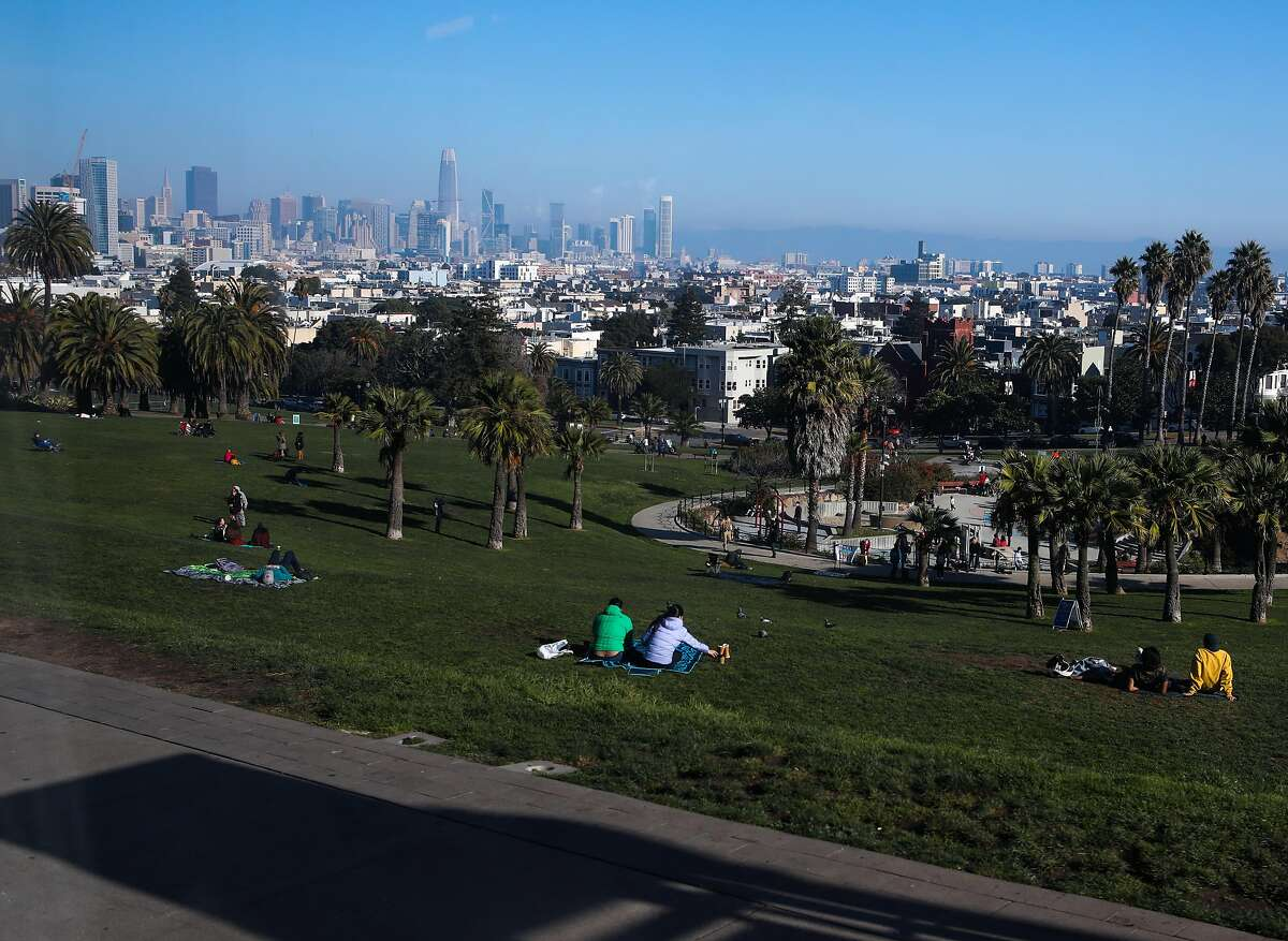 People gather in Dolores Park on a Saturday in December -A federal appeals court has upheld Gov. Gavin Newsom's restrictions on private indoor and outdoor gatherings.