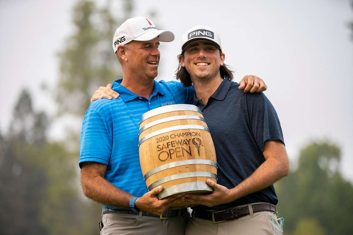 Stewart Cink (left) and his son and caddie, Reagan, celebrate with the trophy after Cink won the Safeway Open at Silverado Resort on Sept. 13, 2020.