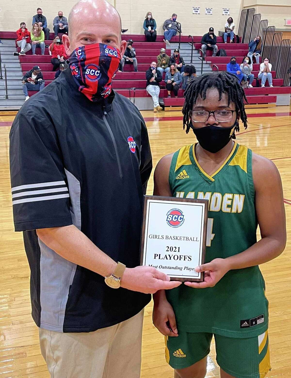 SCC Division I tournament Most Outstanding Player Diamond White, right, poses with SCC Commissioner Al Carbone.