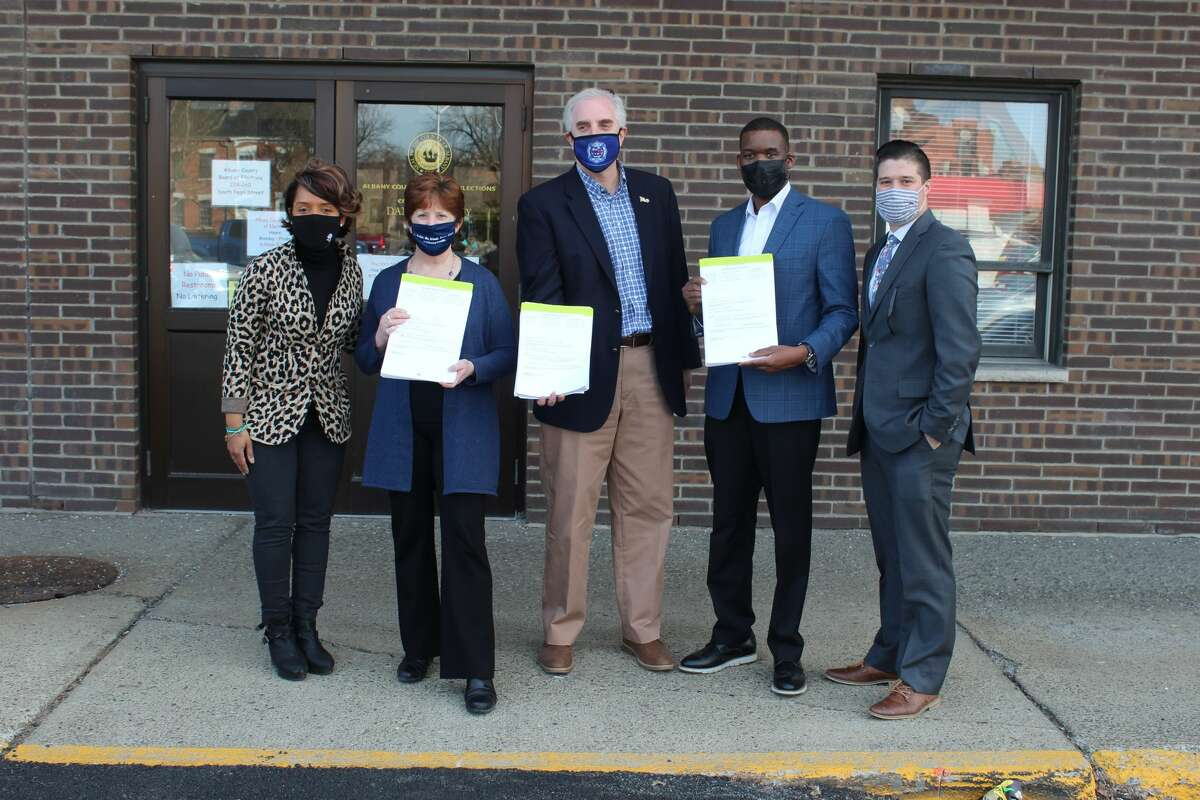 Chief City Auditor Dorcey Applyrs, Mayor Kathy Sheehan, City Treasurer Darius Shahinfar, Common Council President Corey Ellis and Democratic Party chairman Jake Crawford outside the Albany County Board of Elections building before handing in their petitions.