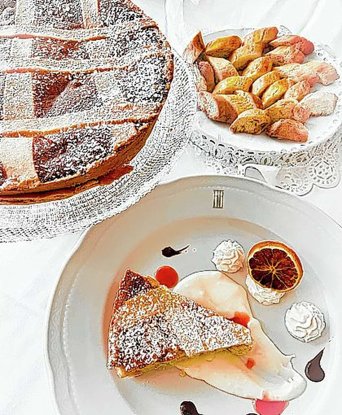 Neapolitan Pastiera is a traditional Italian Easter cake with a texture somewhere in the middle of where cheesecake, custard and souffle meet.