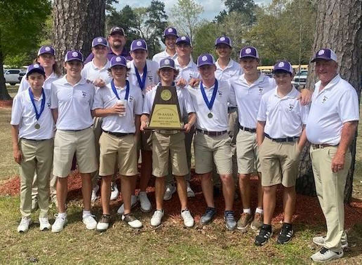The Montgomery boys golf team poses with the District 20-5A championship trophy at Lake Windcrest Golf Club in Magnolia, Texas on March 30, 2021.