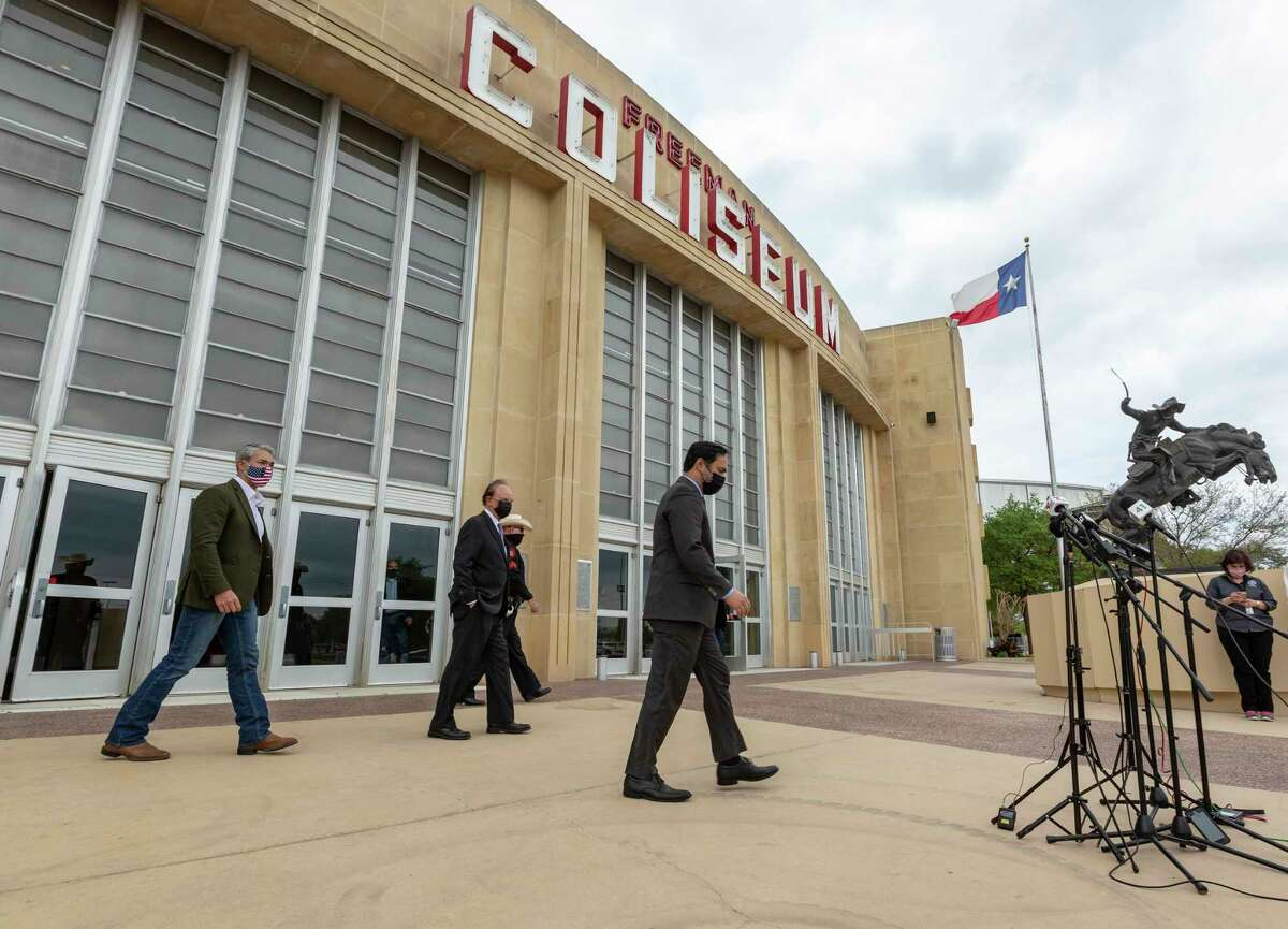 San Antonio mayor Ron Nirenberg, left, County Judge Nelson Wolff, middle, and U.S. Rep. Joaquin Castro walk Tuesday, March 30, 2021 to the microphones outside Freeman Coliseum for a press conference after touring the Health and Human Services unaccompanied minor migrant detention facility.