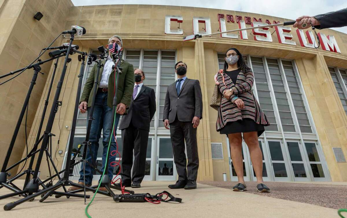 San Antonio mayor Ron Nirenberg, from left, County Judge Nelson Wolff, U.S. Rep. Joaquin Castro, and Rebeca Clay-Flores talk Tuesday, March 30, 2021 outside Freeman Coliseum during a press conference after the delegation toured the Health and Human Services unaccompanied minor migrant detention facility.