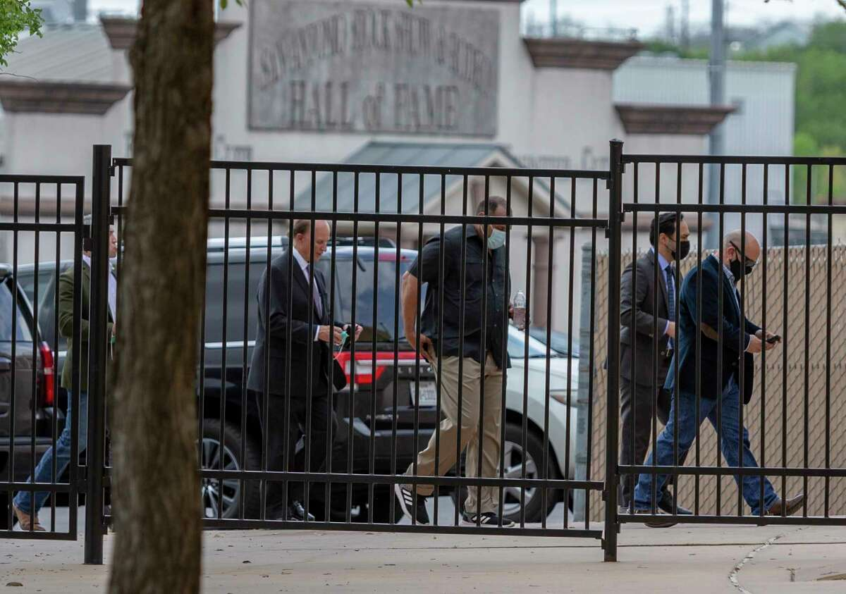 County Judge Nelson Wolff, left, and U.S. Rep. Joaquin Castro, second from right, make their way to a news conference Tuesday, March 30, 2021 outside Freeman Coliseum after touring the Health and Human Services unaccompanied minor migrant detention facility on the Freeman Coliseum grounds.