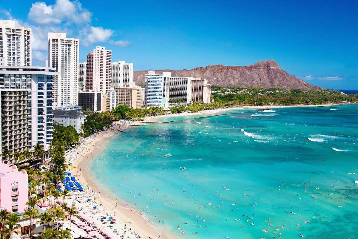 Resort travel vacation destination, Waikiki Beach with Diamond Head Crater. hotels and resorts around beach in Honolulu, Oahu, Hawaii.