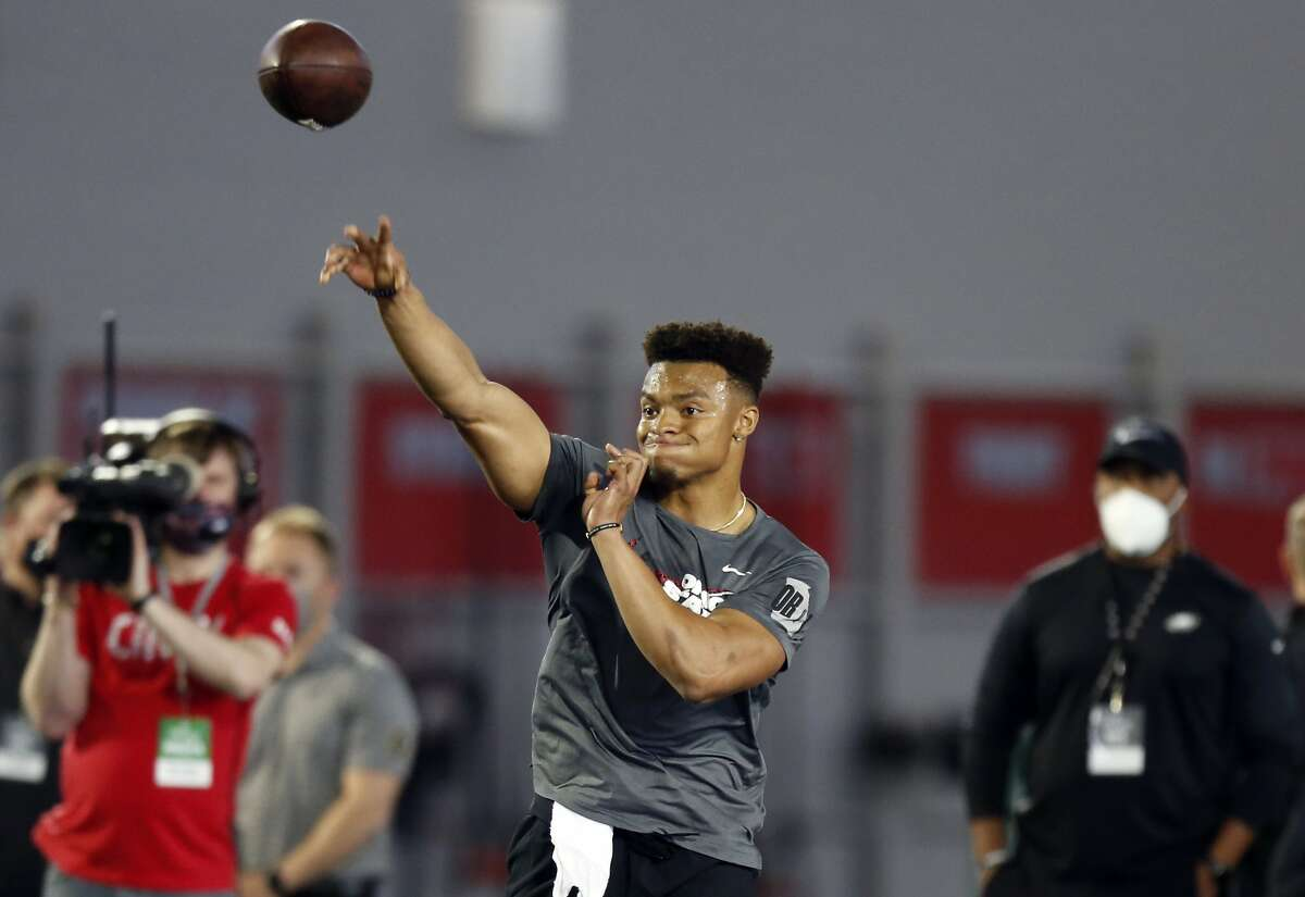 Quarterback Justin Fields throws as part of a drill during an NFL Pro Day at Ohio State University, Tuesday, March 30, 2021, in Columbus, Ohio. (AP Photo/Paul Vernon)