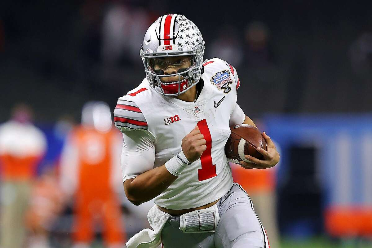 Justin Fields (1) of the Ohio State Buckeyes runs with the ball in the first half against the Clemson Tigers during the College Football Playoff semifinal game at the Allstate Sugar Bowl at Mercedes-Benz Superdome on Jan. 1, 2021 in New Orleans, Louisiana. (Kevin C. Cox/Getty Images/TNS)