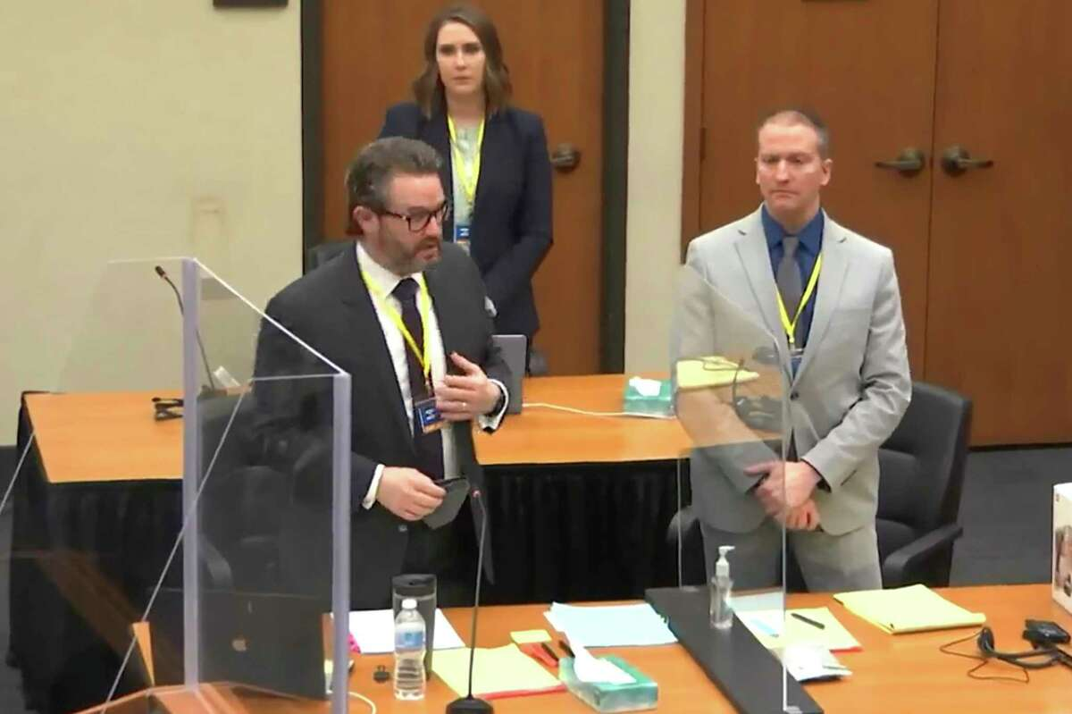 In this screen grab from video, defense attorney Eric Nelson, left, defendant and former Minneapolis police officer Derek Chauvin, right, and Nelson's assistant Amy Voss, back, introduce themselves to jurors as Hennepin County Judge Peter Cahill presides over jury selection in the trial of Chauvin Wednesday, March 17, 2021 at the Hennepin County Courthouse in Minneapolis, Minn. Chauvin is charged in the May 25, 2020 death of George Floyd.