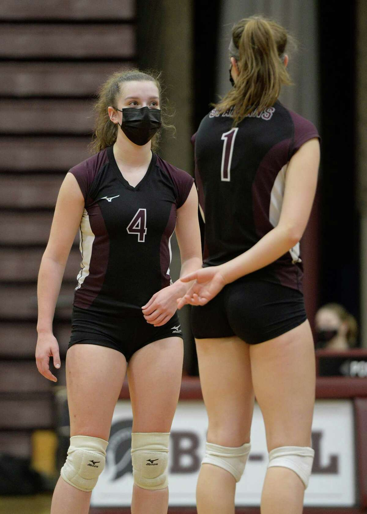 Burnt Hills?•s Claire Isaksen (4) speaks to Carlie Rzeszotarski between serves during a game against Saratoga on Tuesday, Mar. 30, 2021, in Burnt Hills, N.Y. (Jenn March, Special to the Times Union)