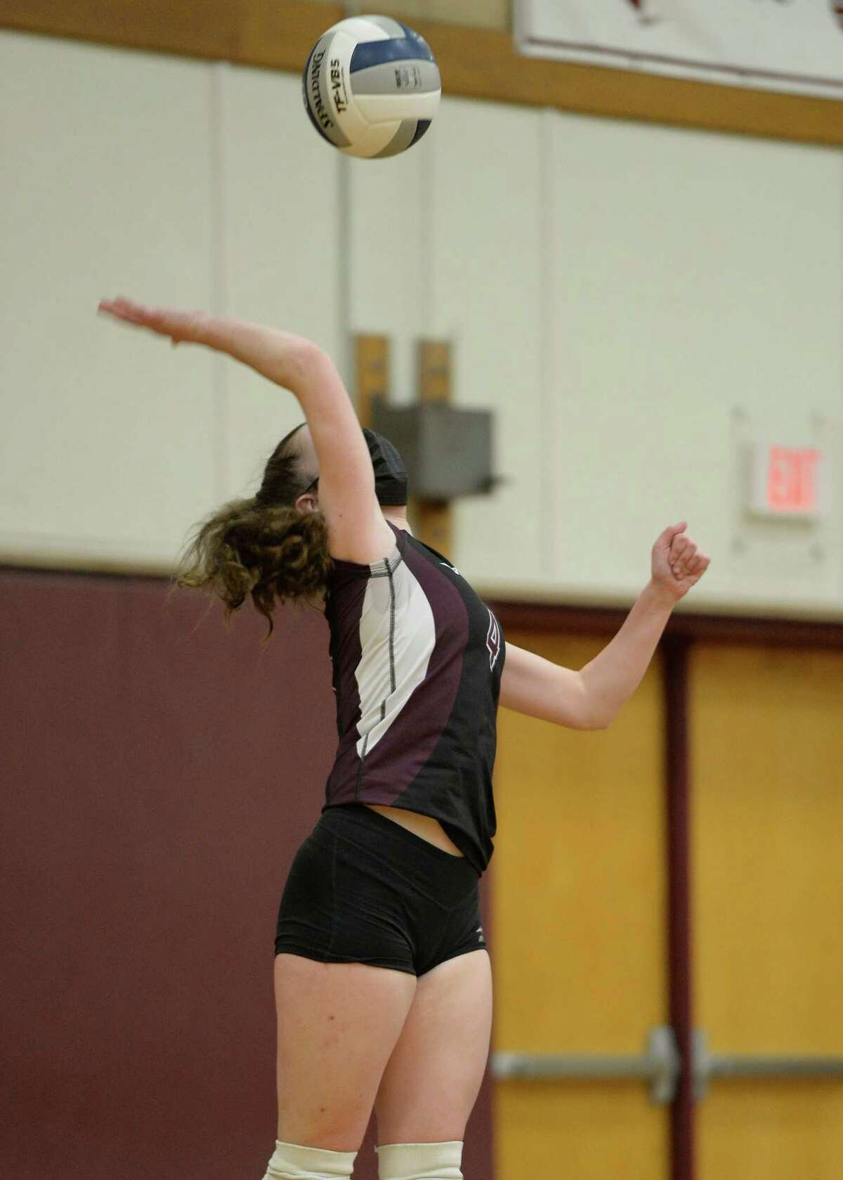 Burnt Hills?•s Claire Isaksen serves the ball during a game against Saratoga on Tuesday, Mar. 30, 2021, in Burnt Hills, N.Y. (Jenn March, Special to the Times Union)