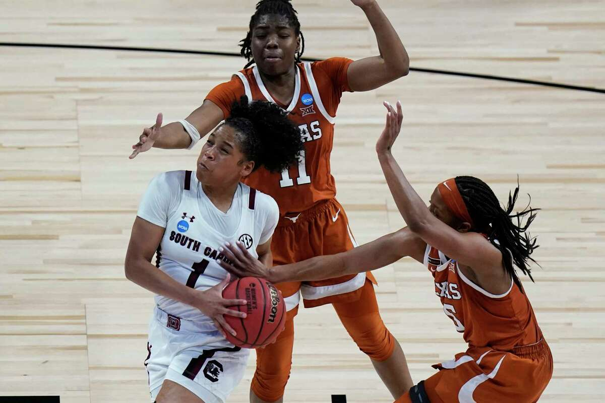 South Carolina guard Zia Cooke (1) drives to the basket past Texas guard Joanne Allen-Taylor (11) and guard Kyra Lambert (15) during the second half of a college basketball game in the Elite Eight round of the women's NCAA tournament at the Alamodome in San Antonio, Tuesday, March 30, 2021. (AP Photo/Eric Gay)