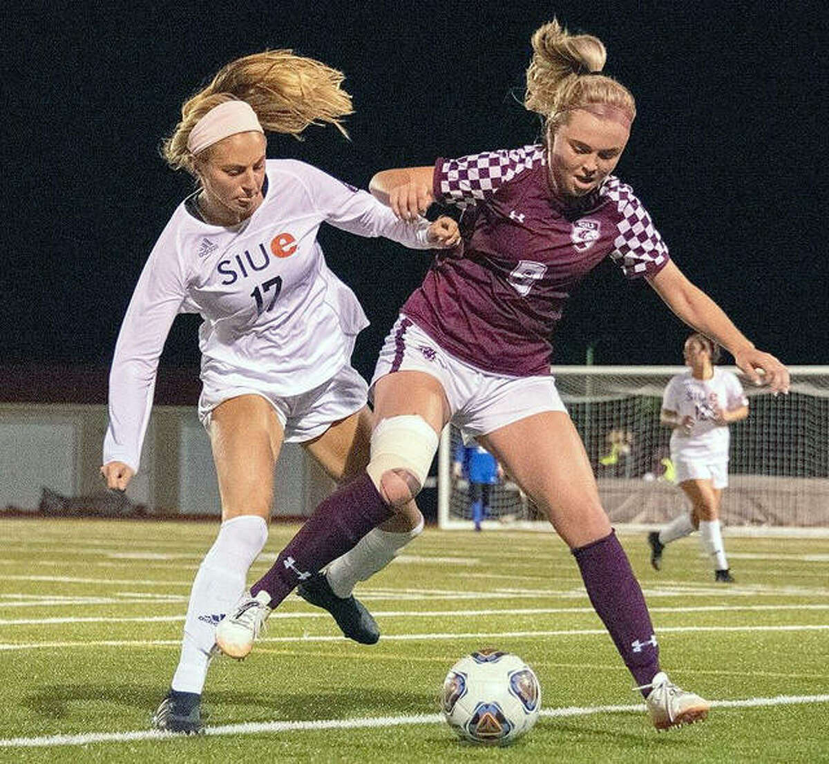 MacKenzie Litzsinger of SIUE, left, scored the only goal of the game in the Cougars' 1-0 victory over Tennessee Tech Tuesday in Cookeville, Tenn. She is shown in 2019 action against SIU Carbondale.