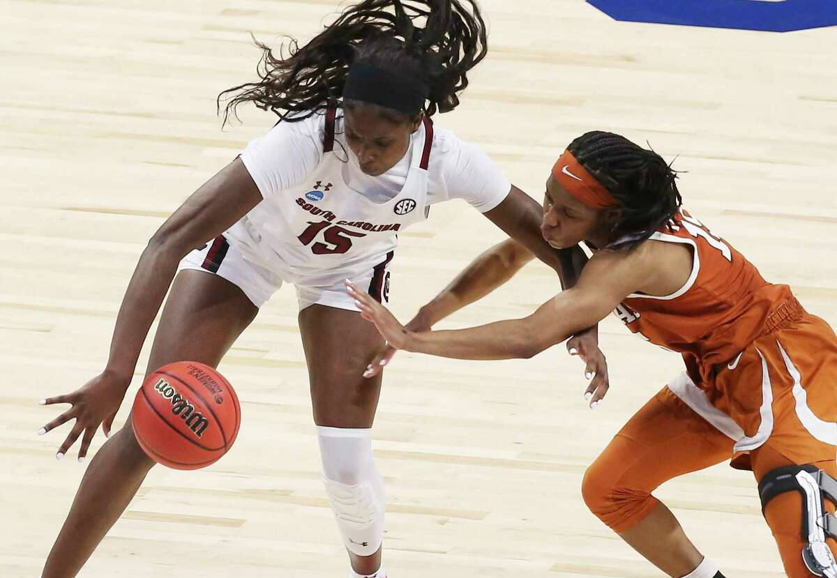 Texas' Kyra Lambert (15) attempts a steal against South Carolina's Laeticia Amihere (15) during their Elite Eight regional championship game of the 2021 NCAA Women's Basketball tournament at the Alamodome on Tuesday, Mar. 30, 2021.
