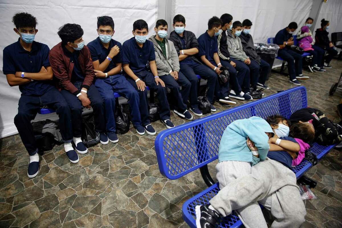 Young unaccompanied migrants wait for their turn at the secondary processing station inside the U.S. Customs and Border Protection facility, the main detention center for unaccompanied children in the Rio Grande Valley, in Donna, Texas, Tuesday, March 30, 2021. The Biden administration on Tuesday for the first time allowed journalists inside its main detention facility at the border for migrant children, revealing a severely overcrowded tent structure where more than 4,000 kids and families were crammed into pods and the youngest kept in a large play pen with mats on the floor for sleeping.(AP Photo/Dario Lopez-Mills, Pool)