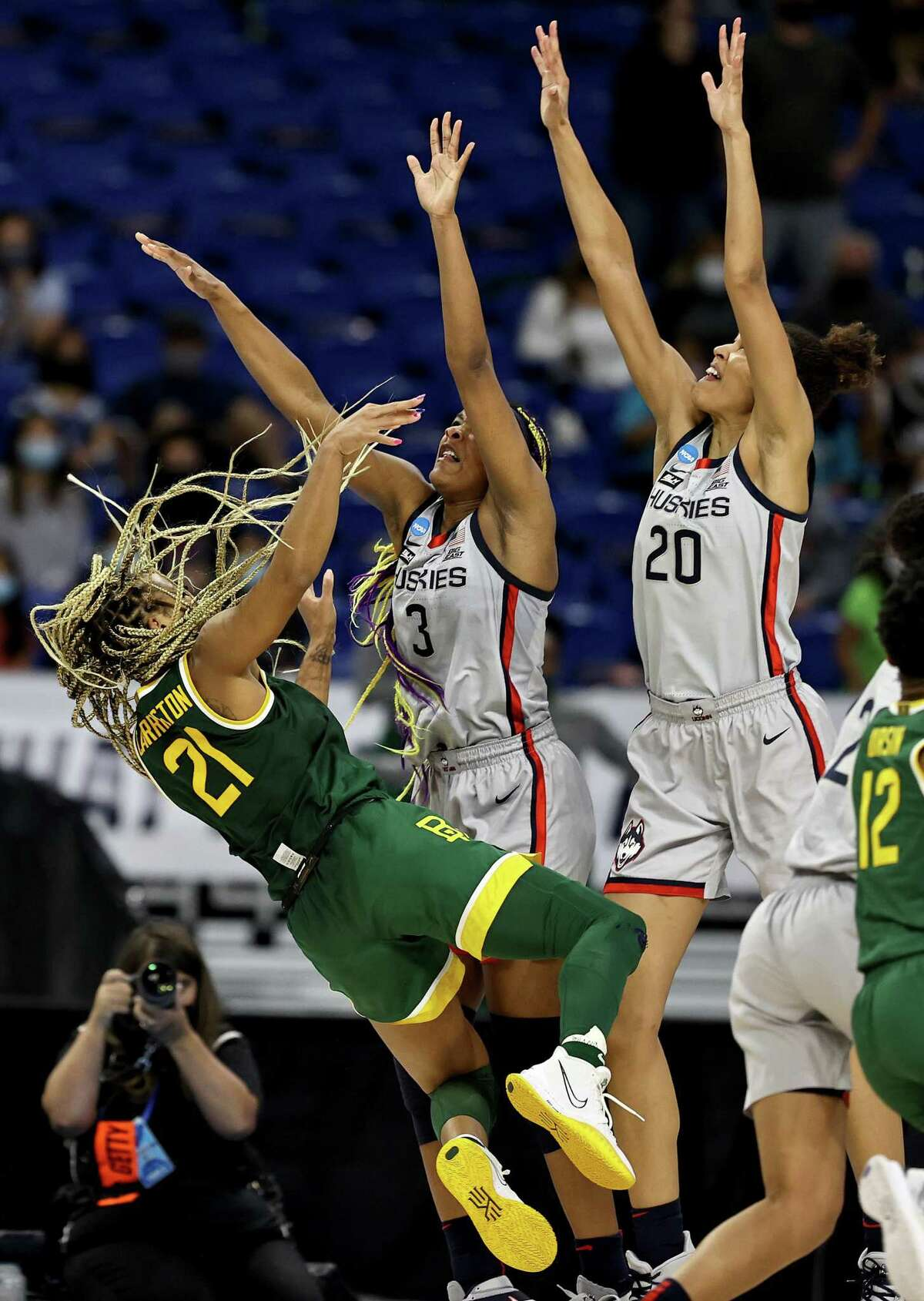 DiJonai Carrington (21) of the Baylor Lady Bears tries to take a shot as Aaliyah Edwards (3) and Olivia Nelson-Ododa (20) of the UConn Huskies defend in the final minutes of the game during the Elite Eight round of the Women's NCAA Tournament at the Alamodome on Monday in San Antonio, Texas. The UConn Huskies defeated the Baylor Lady Bears 69-67 to advance to the Final Four.