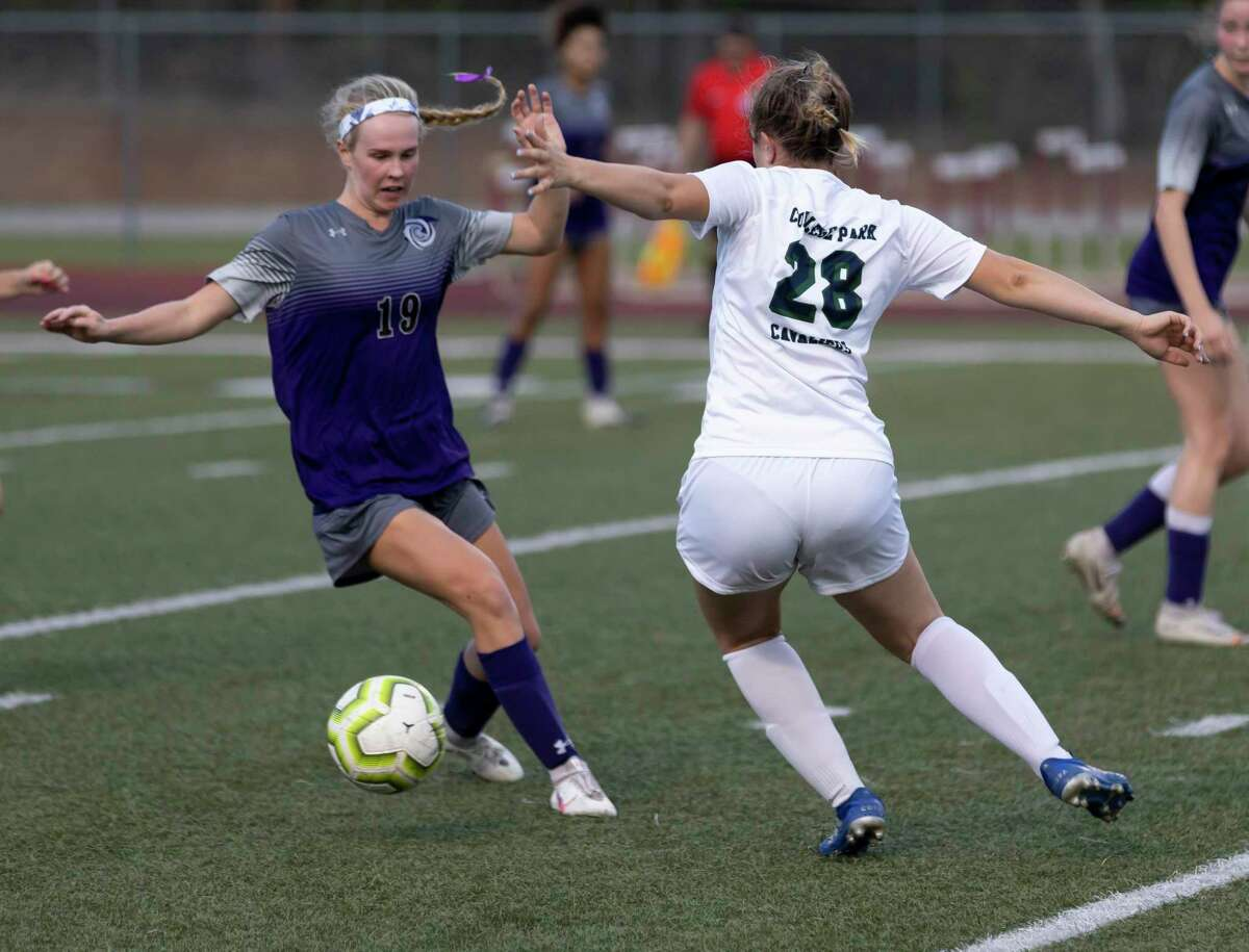 College Park Jenna Jackson (28) attempts to steal control of the ball from Klein Cain defense Haylee Goodrich (19) during the second half of a Region II-6A area playoff match at Magnolia West High School, Tuesday, March 30, 2021, in Magnolia.