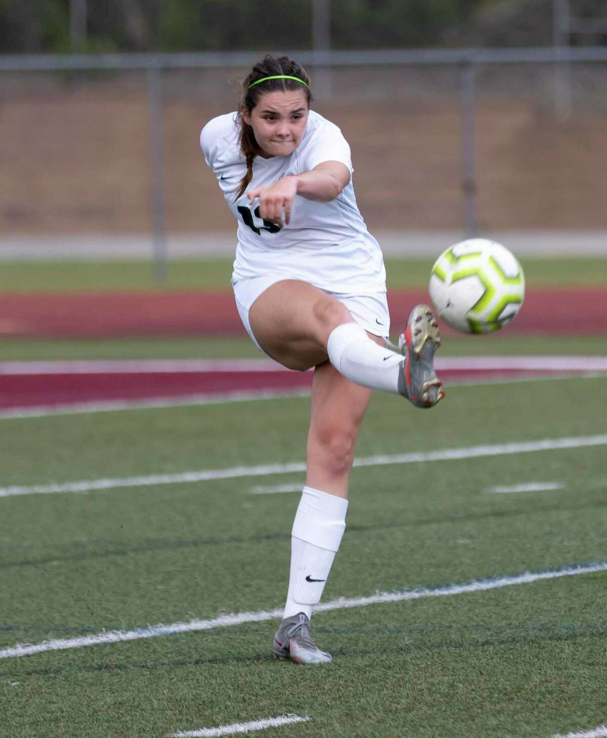 College Park Sara Kelly (18) kicks the ball during the first half of a Region II-6A area playoff match against Klein Cain at Magnolia West High School, Tuesday, March 30, 2021, in Magnolia.