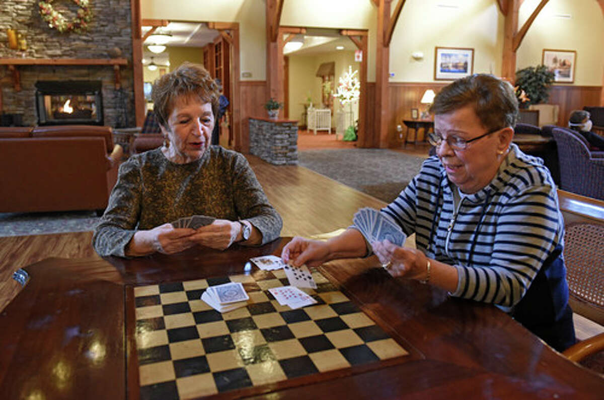 Avila residents Marilyn Seidenberg, left, and Kathy DeLaMater play cards at the Avila Retirement Community on Monday, March 29, 2021 in Albany, N.Y. (Lori Van Buren/Times Union)