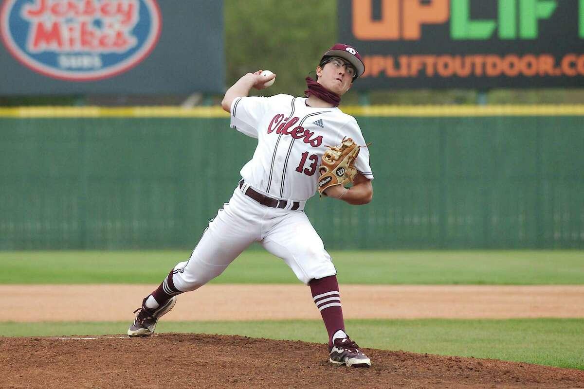Pearland's Garrett Coiner (13) pitches against Dawson Tuesday at Pearland High School.