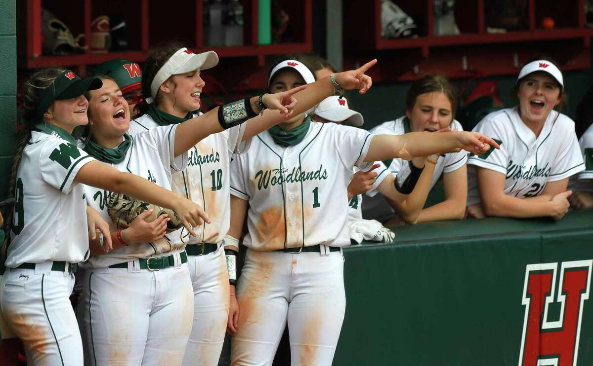 The Woodlands players cheer during the fourth inning of a high school softball game at The Woodlands High School, Saturday, Feb. 27, 2021, in The Woodlands.