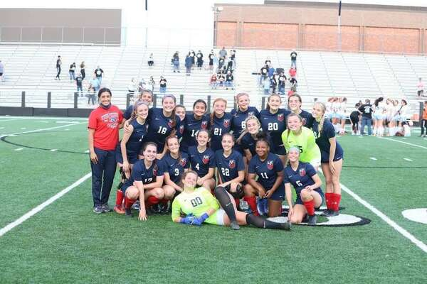 The Hardin-Jefferson girls soccer team poses for a picture Tuesday night after a 2-0 win over Sweeny in the Class 4A area round.