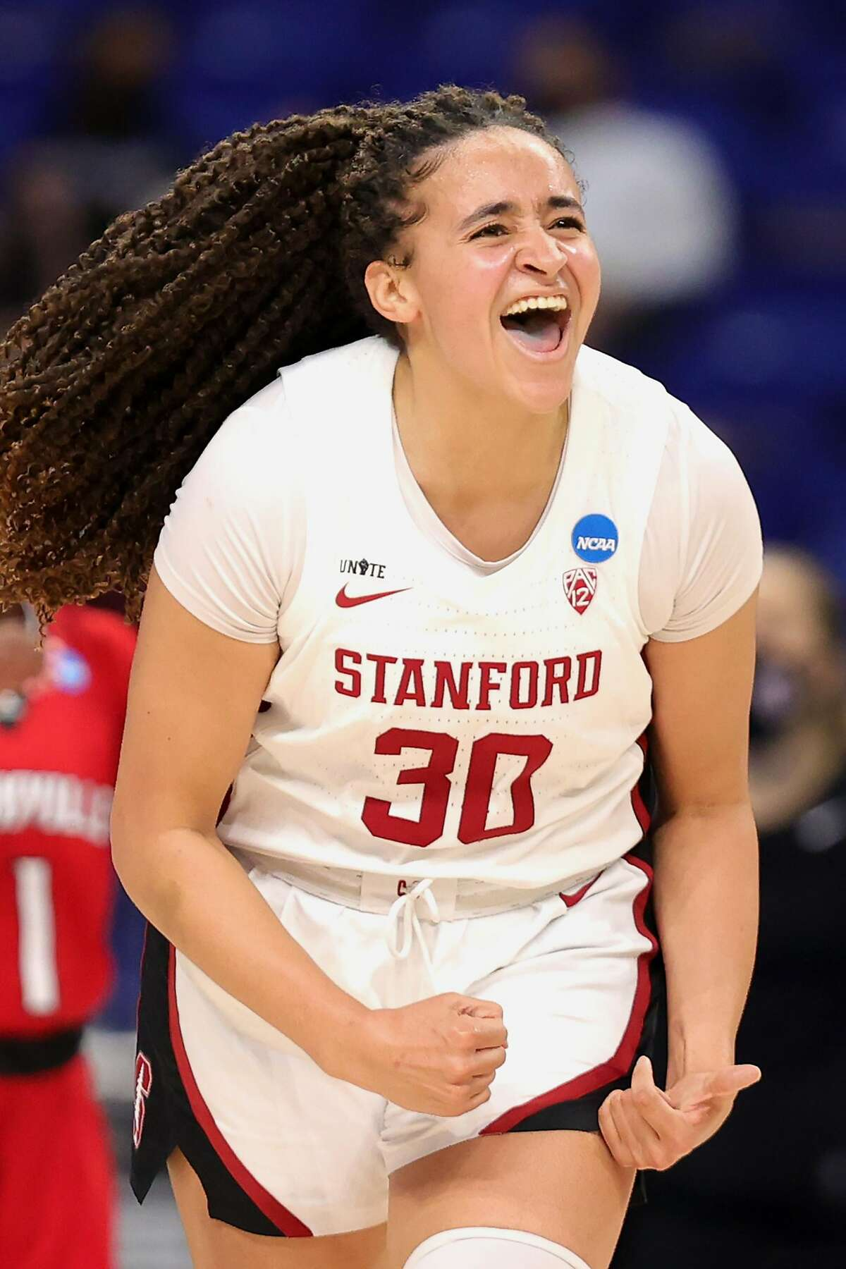 SAN ANTONIO, TEXAS - MARCH 30: Haley Jones #30 of the Stanford Cardinal reacts during the second half against the Louisville Cardinals in the Elite Eight round of the NCAA Women's Basketball Tournament at the Alamodome on March 30, 2021 in San Antonio, Texas. (Photo by Carmen Mandato/Getty Images)