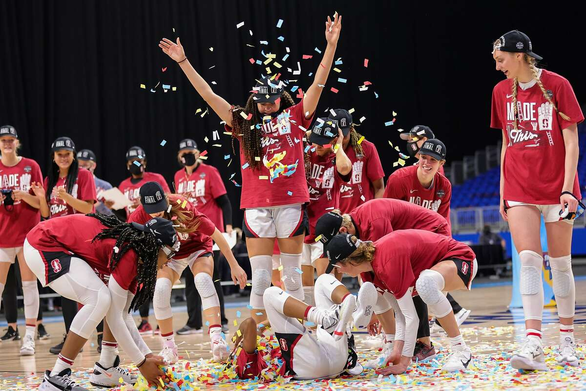 SAN ANTONIO, TEXAS - MARCH 30: The Stanford Cardinal celebrate their win over the Louisville Cardinals in the Elite Eight round of the NCAA Women's Basketball Tournament at the Alamodome on March 30, 2021 in San Antonio, Texas. (Photo by Carmen Mandato/Getty Images)