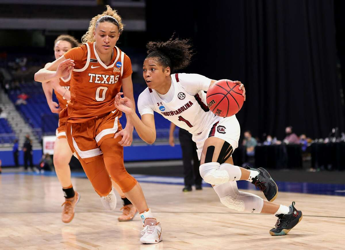 South Carolina's Zia Cooke drives to the basket against Texas' Celeste Taylor during their Elite Eight game in San Antonio.