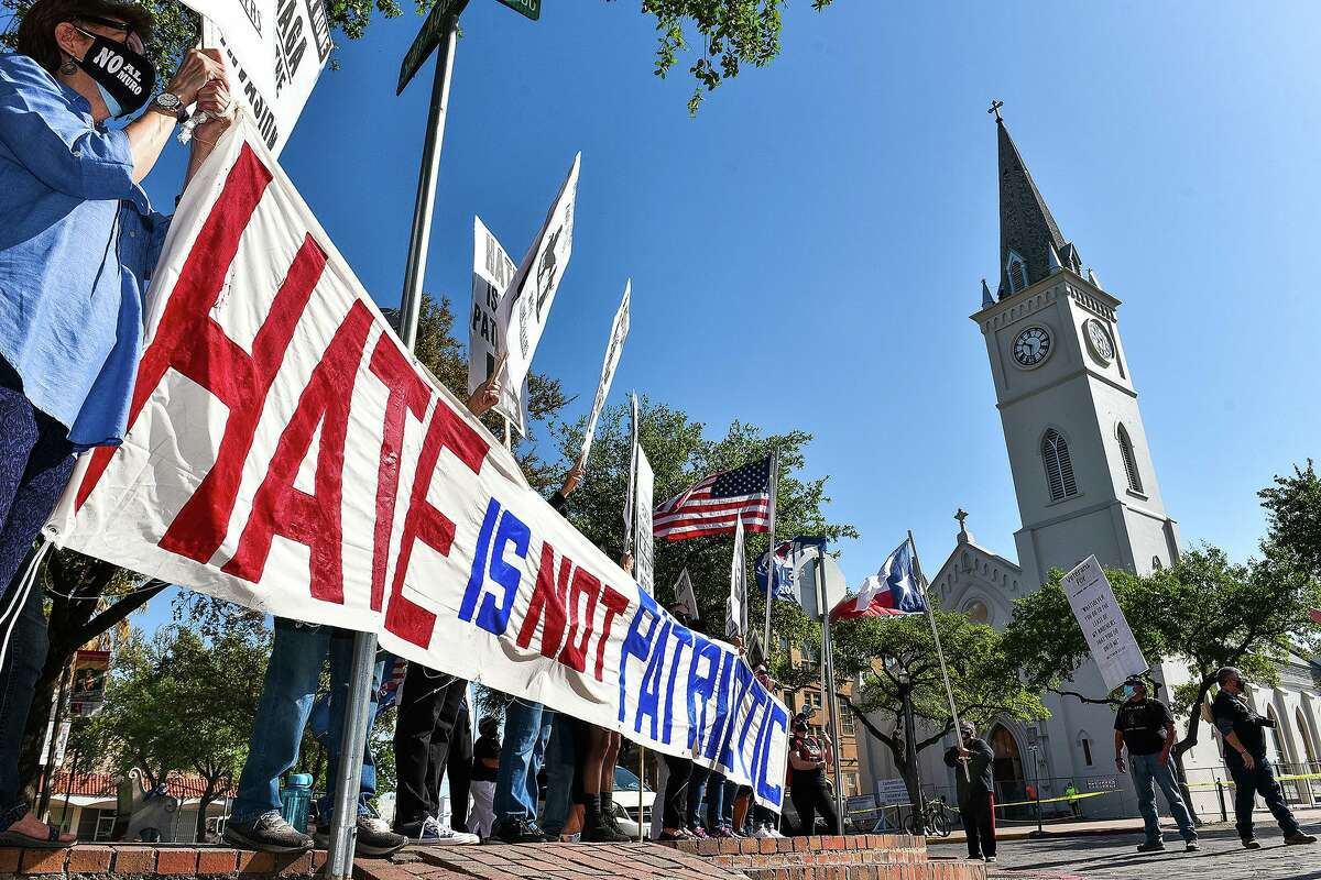 The No Border Wall Coalition and other activists gather near a meeting of the Republican Party of Texas in protest of rhetoric used when discussing immigration and border security, Friday, March 26 at San Agustin Plaza.