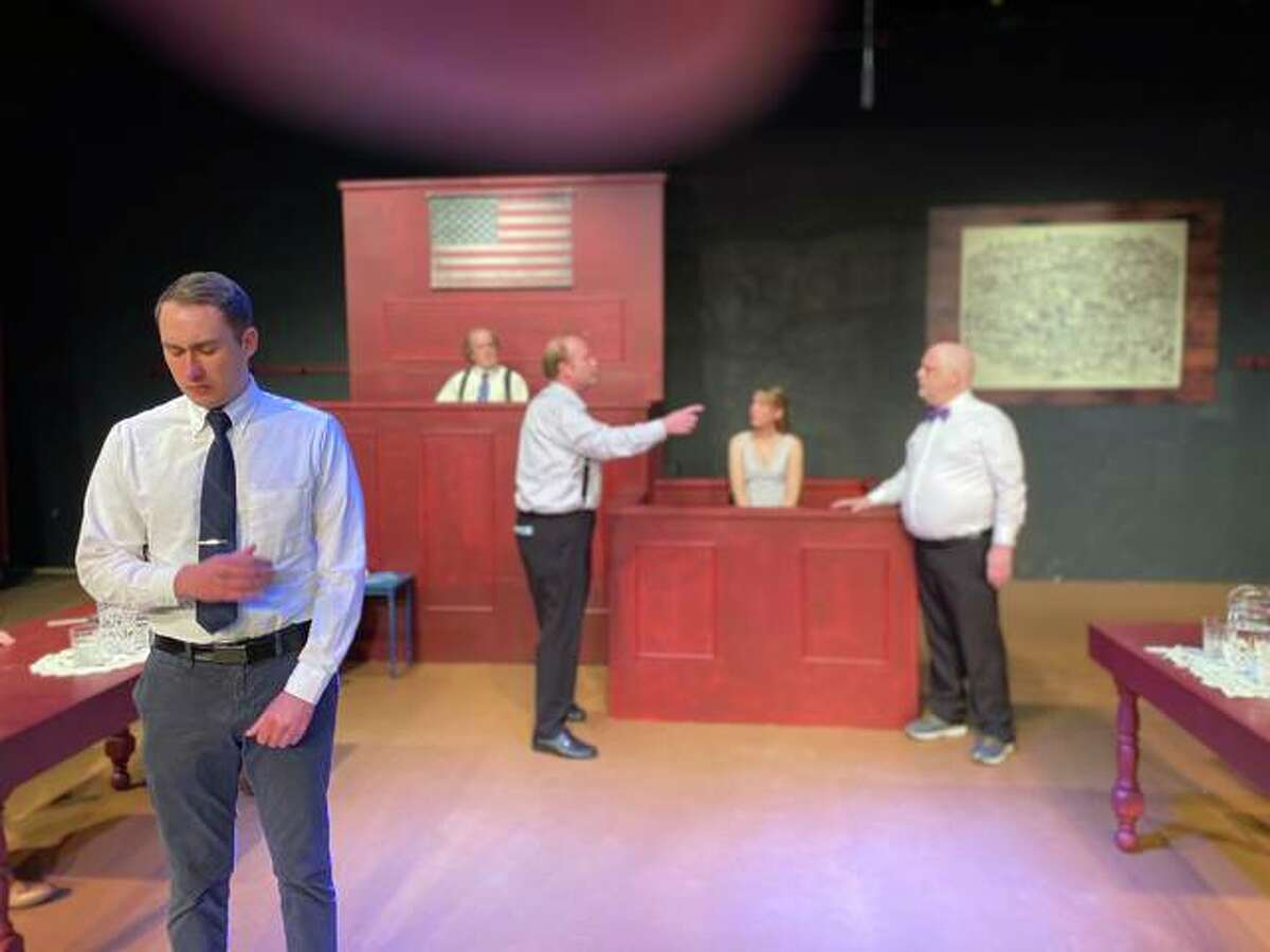 Michael Arthur, front, as a young teacher on trial, and, background from left, the judge (Hal Morgan), Matthew Harrison Brady (Shea Maples, who received a Best Actor nomination for this performance for an Arts For Life's community theater excellence award), the minister's daughter Rachel Brown (Megan Kolosieke) and Henry Drummond (Howard S. Bell, who received a Best Actor nomination for this performance for an Arts For Life's community theater excellence award).
