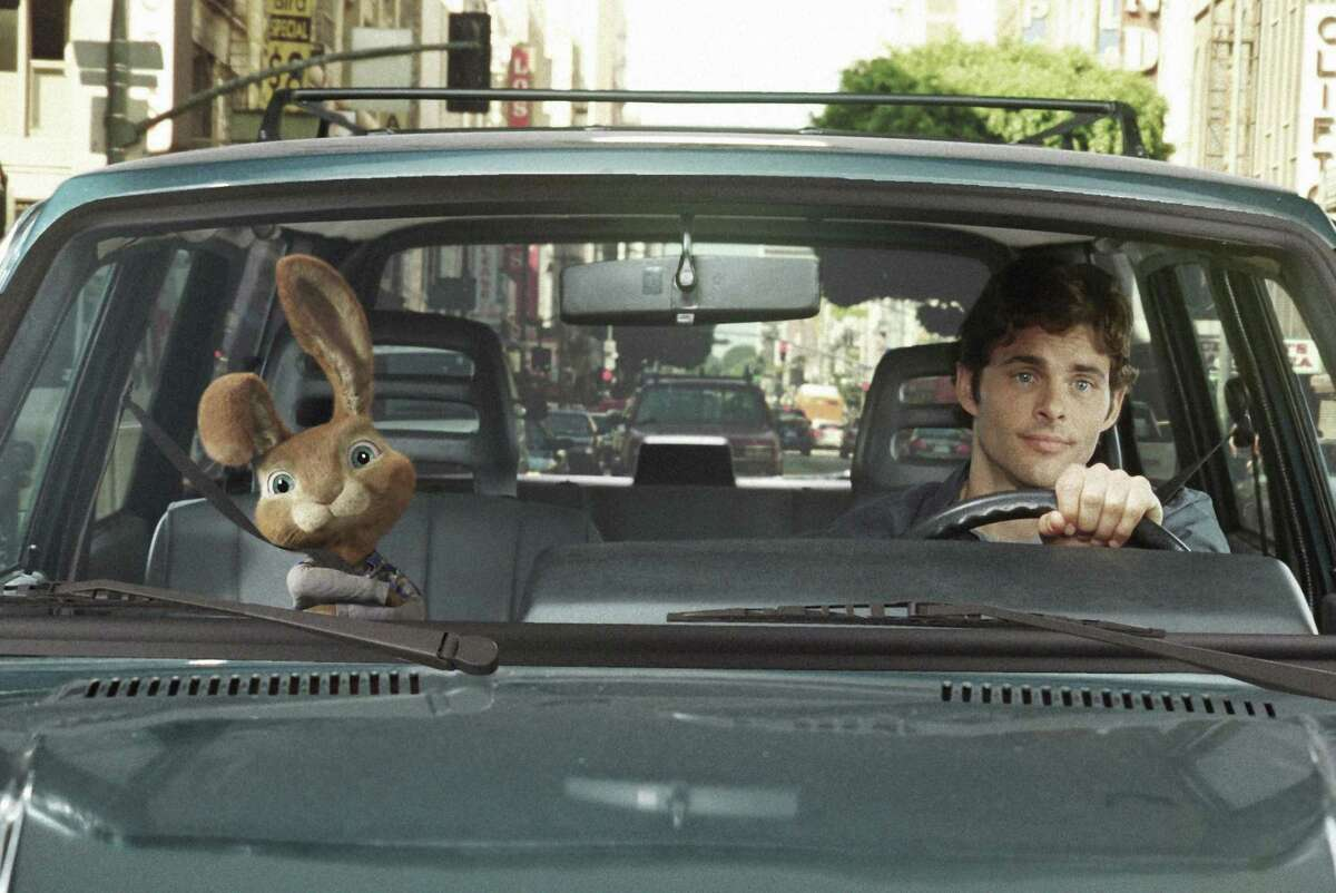 """E.B. (Russell Brand), the heir to the Easter bunny title, goes for a drive with his new friend """"James Marsden) in """"Hop."""""""