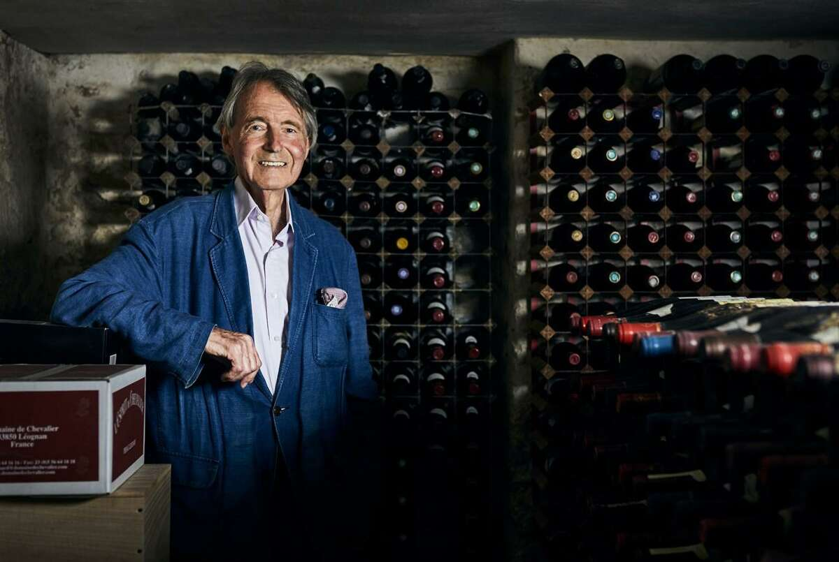 Steven Spurrier poses in his wine cellar at his home in Dorset, England, in 2020.