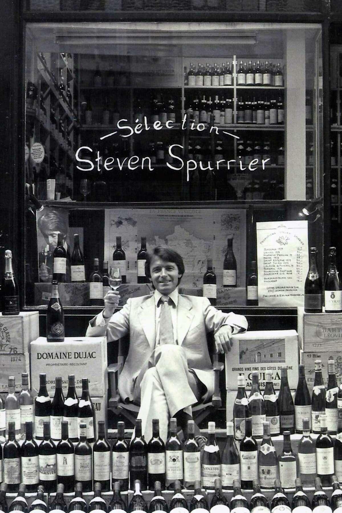 Steven Spurrier poses outside his Paris wine shop, Les Caves de la Madeleine, circa 1980.
