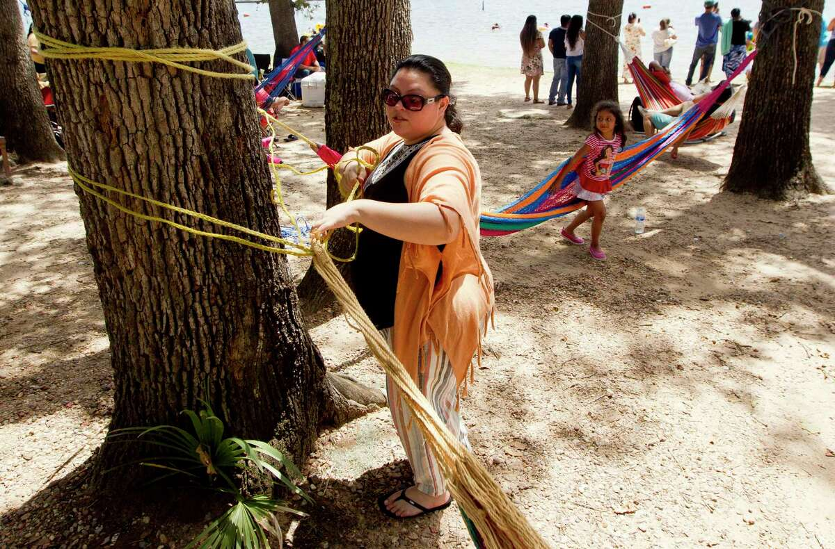 Gloria Lopez sets up a hamek during a visit to Lake Conroe Park, Saturday, July 6, 2019, in Conroe.