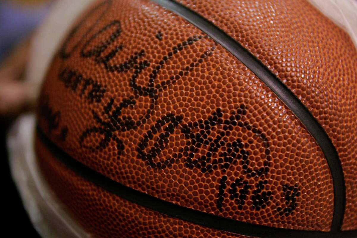 A basketball signed by David Lattin during a visit to his alma mater Worthing High School in 2006.