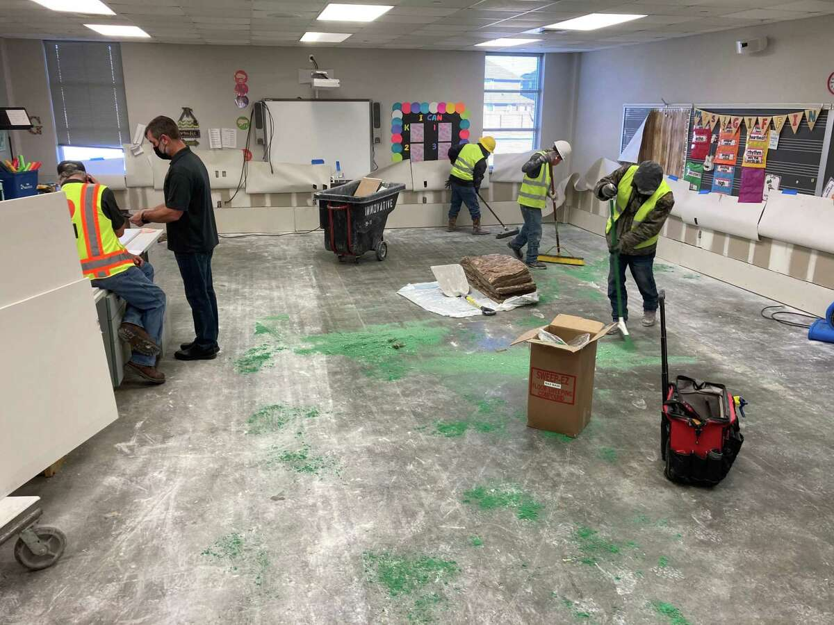 Katy Independent School District is faced with millions in damages left behind by February's winter storm. Here, a crew works on Friday, Feb. 19, to clean up damages in a classroom at Schmalz Elementary.