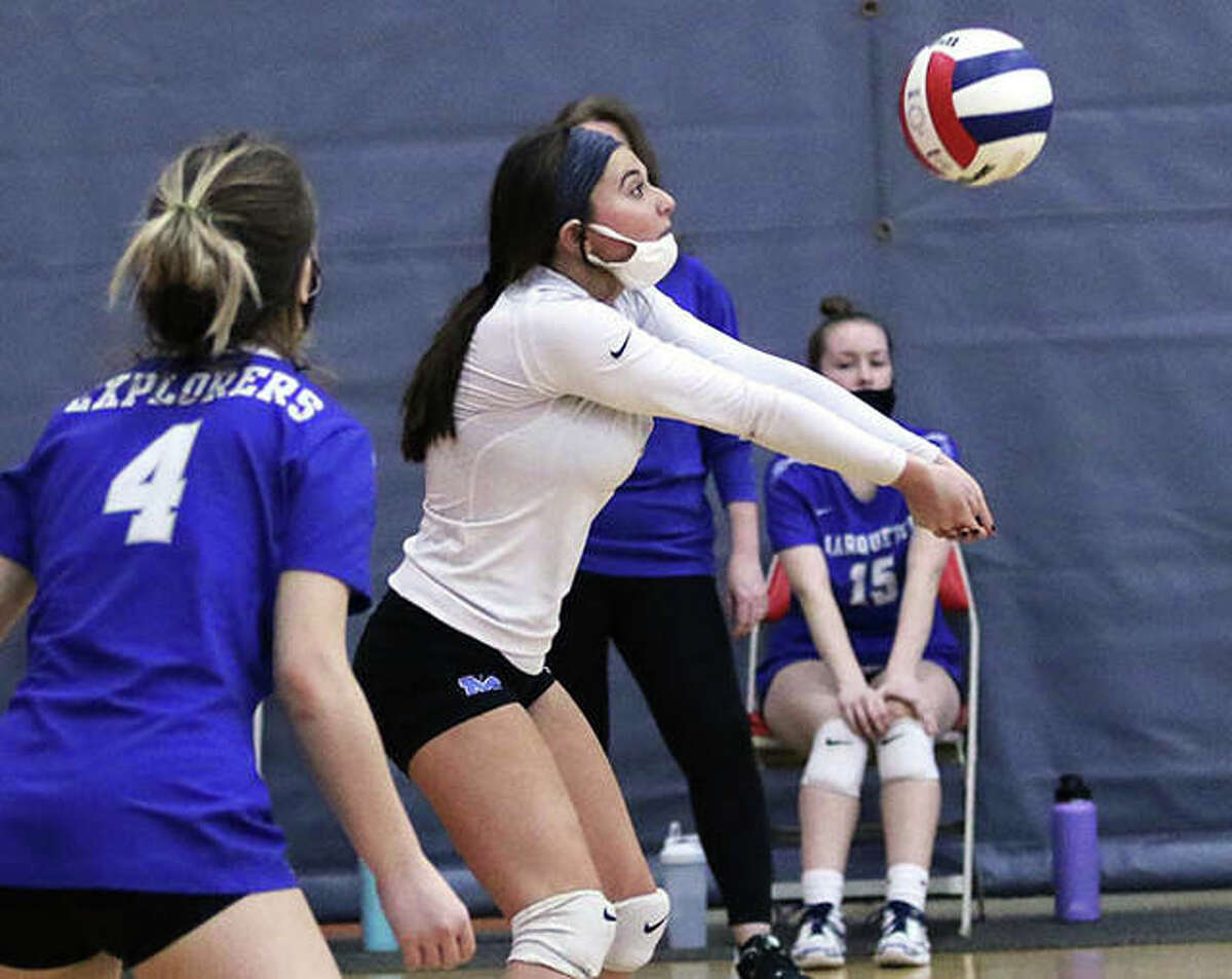 Marquette Catholic's Ellie Jacobs, shown receiving a serve in Saturday's match at Alton High, was one of eight seniors honored before Tuesday night's win over Roxana in Alton.