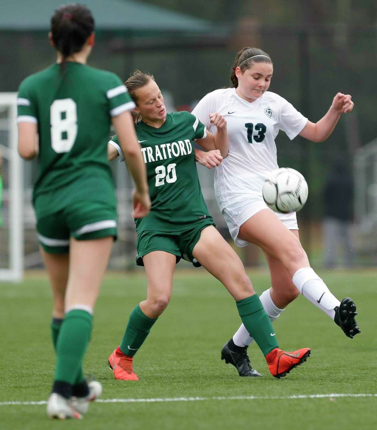 College Park's Kendall Cagney (13) collides with Stratford's Rileigh Toner (20) in the first period of a match during the Lady Highlander Invitational at Gosling Sports Complex, Thursday, Jan. 2, 2020, in The Woodlands.