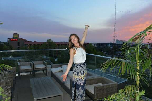 Richele Rainosek poses for a picture while enjoying the view from the Fairmount Rooftop Oyster Bar.